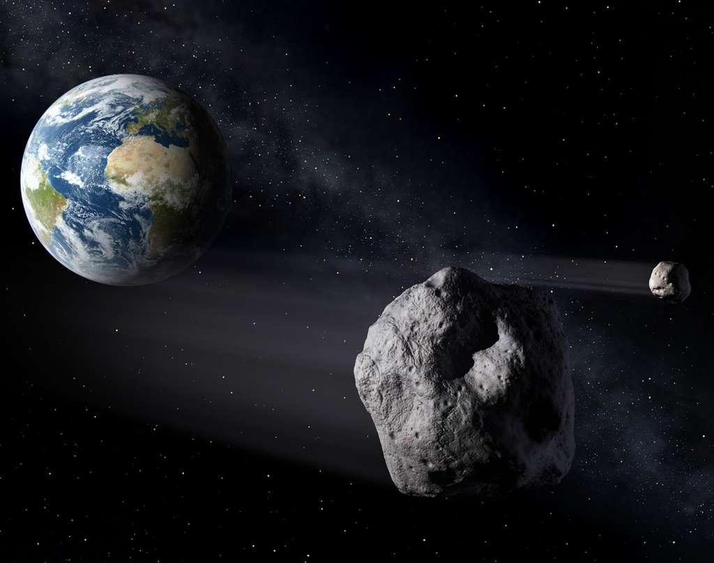 Cette vue d'artiste montre des astéroïdes s'approchant de la Terre. Les experts de l'Esa souhaitent coordonner leurs efforts en matière de détection et éventuellement de déviation de ces objets dangereux. © P.Carril, Esa