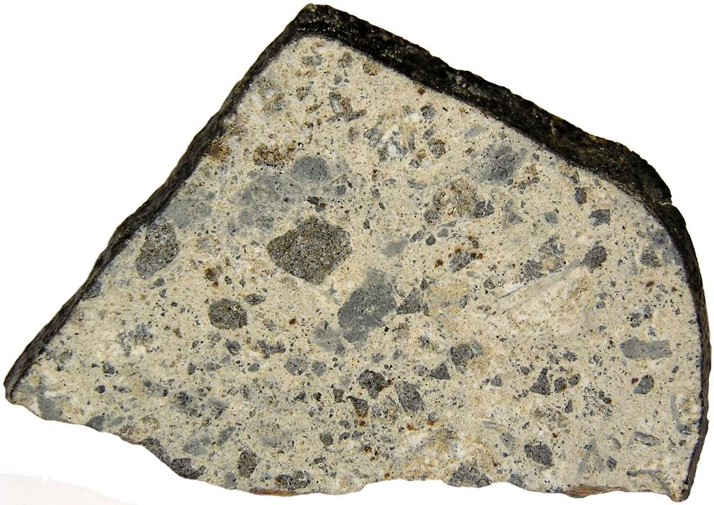 Une coupe de l'eucrite Northwest Africa 1836 trouvée au Maroc. © Meteorites Australia, www.meteorites.com.au.