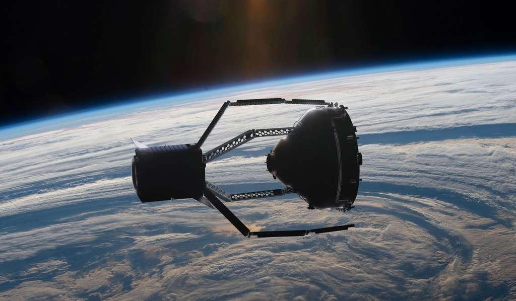 Clear-Space 1 en train de saisir avec sa pince géante un débris spatial. Cette mission s'inscrit dans le cadre du projet Adrios (Active Debris Removal/In-Orbit Servicing) du programme de Sécurité spatiale de l'ESA. © ESA