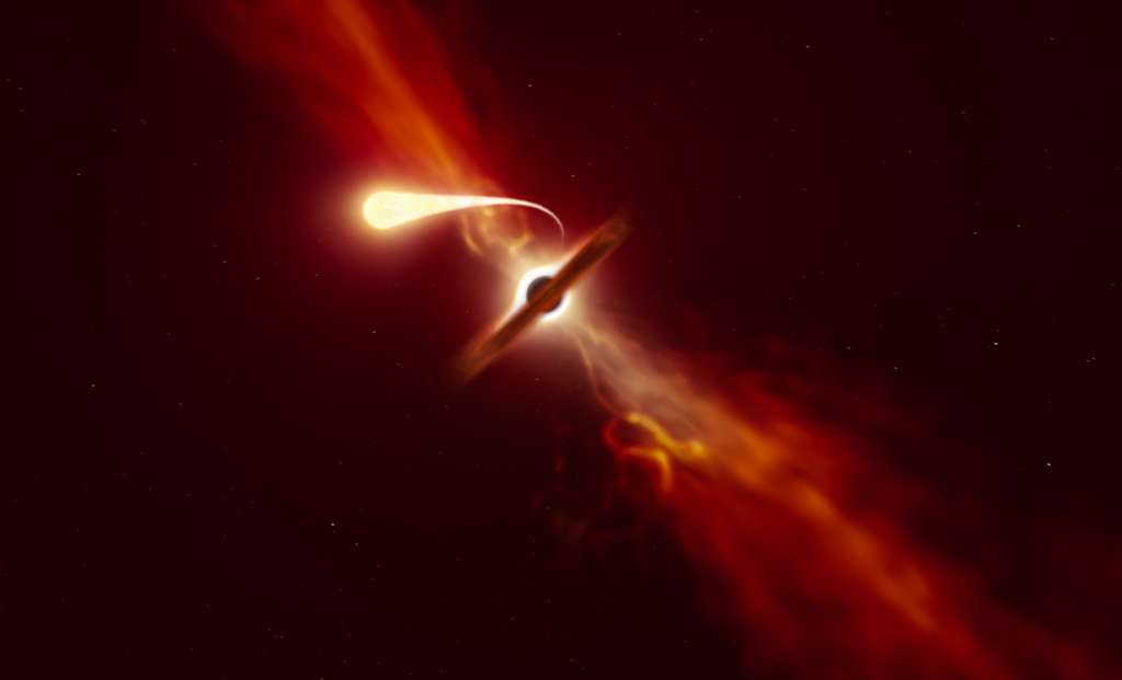 """Cette illustration montre une étoile (au premier plan) en train de se """"spaghettiser"""" alors qu'elle est aspirée par un trou noir supermassif (en arrière-plan) lors d'un """"événement de rupture par effet de marée"""". © ESO, M. Kornmesser"""
