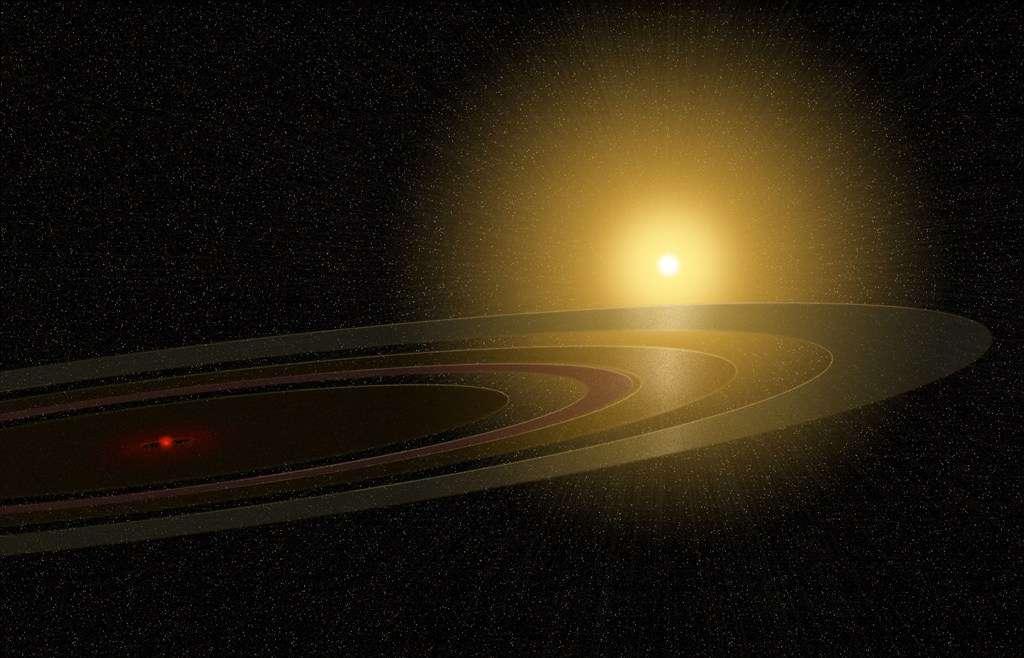 Une vue d'artiste des anneaux entourant peut-être une naine rouge autour de l'étoile 1SWASP J140747.93-394542.6. © Mike Osadciw