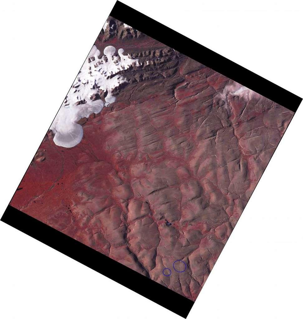 Cette image de l'Advanced spaceborne thermal emission and reflection radiomete (Aster) de la Nasa prise le 14 juillet 2020 montre la disparition des deux calottes de la baie Saint-Patrick (Canada). © Bruce Raup, National Snow and Ice Data Center