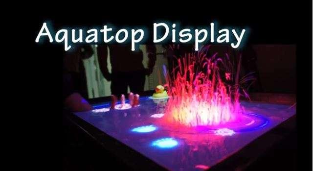 AquaTop se compose d'un projecteur vidéo, d'un capteur Kinect et d'enceintes étanches. Sur une surface liquide rendue opaque par des sels de bain, l'image projetée peut être manipulée avec les mains et les doigts, et le son subaquatique fournit même un retour d'effet synchronisé avec l'action. Ci-dessus une explosion simulée dans le cadre d'un jeu vidéo. © Laboratoire d'électrocommunication de l'université de Tokyo, YouTube