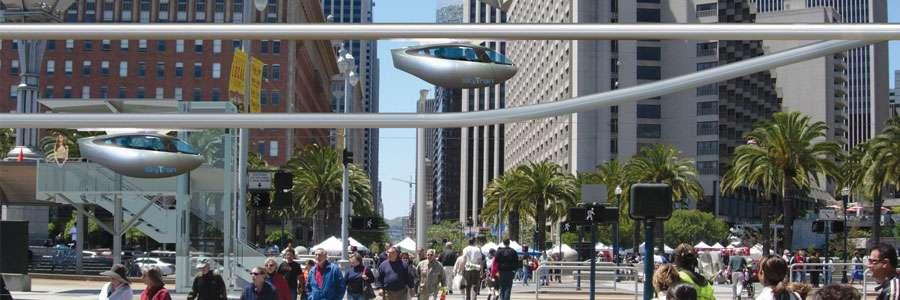 Ce que pourrait être un Skytran : des rails cylindriques portent des véhicules individuels qui glissent à plusieurs dizaines de kilomètres à l'heure. On en loue l'utilisation pour un voyage en les appelant à l'aide d'un smartphone et en se rendant dans l'une des stations d'arrêt. © Skytran US