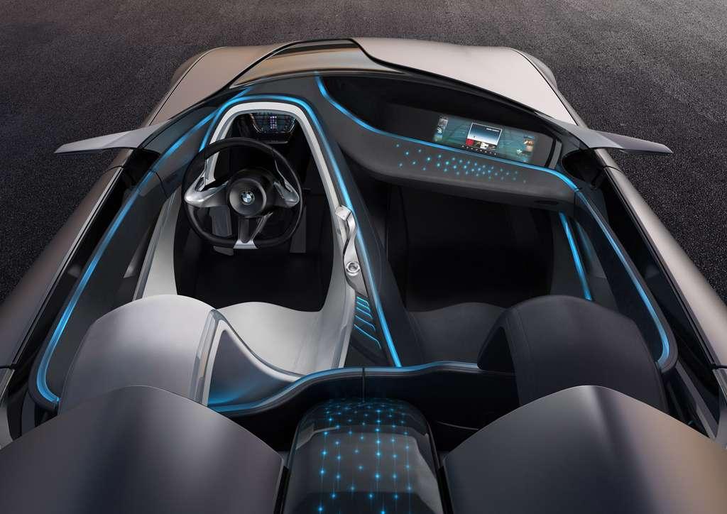 Au salon de Genève 2011, BMW a présenté dans son concept Vision ConnectedDrive une planche de bord recouverte d'un tissu tactile qui commandait un écran de divertissement pour le passager avant. © BMW