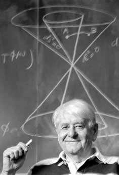 John Moffat expliquant sa théorie de la variabilité de la vitesse de la lumière. Crédit : Suzan King.