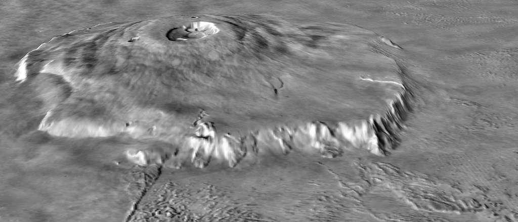 En combinant les données de l'altimètre laser de la sonde Mars Global Surveyor (MOLA) et les images obtenues par les sondes Viking, les scientifiques ont reconstitué cette vue d'Olympus Mons. Pour mieux montrer le relief de l'édifice, ils ont multiplié par dix l'échelle verticale. © Nasa