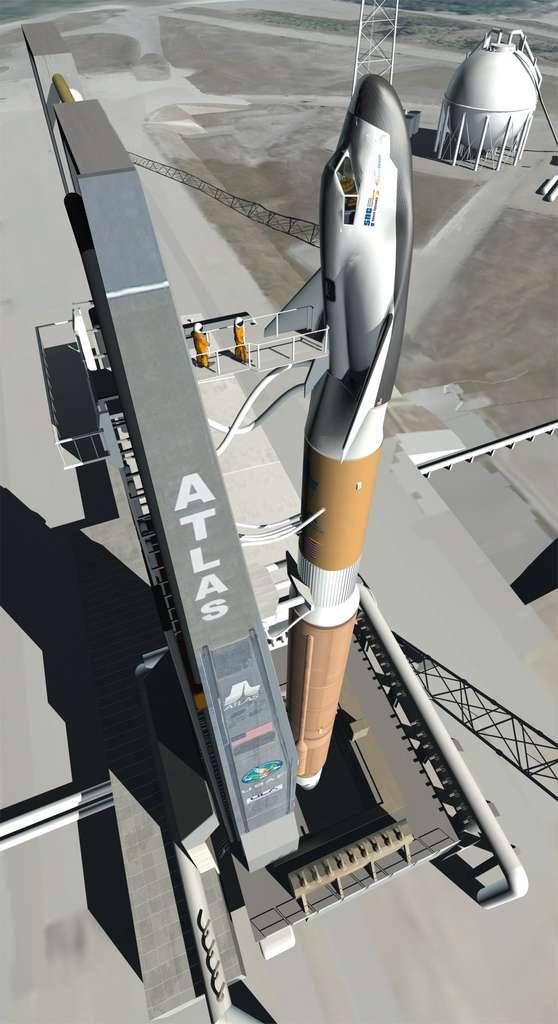 Vue d'artiste du Dream Chaser et de son lanceur Atlas V sur son pas de tir. Parmi les sociétés en compétition pour la fourniture à la Nasa d'un service de transport à destination de l'ISS, Sierra Nevada marque des points, avec un vol d'essai en orbite sans pilote annoncé pour novembre 2016. © Sierra Nevada