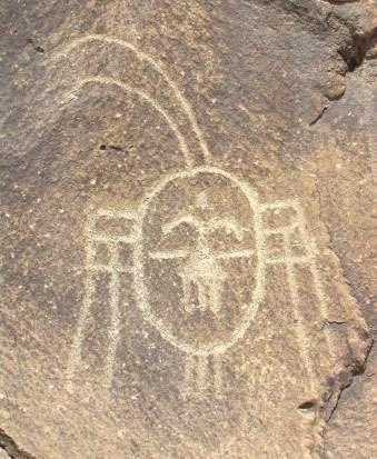 Un visage représenté en art rupestre. © DR