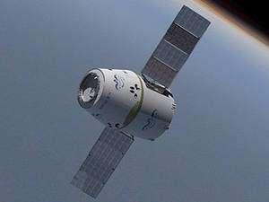 Vue d'artiste de la capsule Dragon de SpaceX qui sera lancé par un Falcon 9. © SpaceX