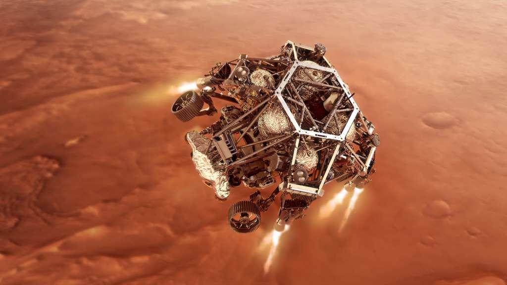 Le rover Perseverance dans les griffes du Sky Crane qui le transporte jusqu'à son site d'atterrissage prévu, le cratère Jezero. © Nasa, JPL-Caltech