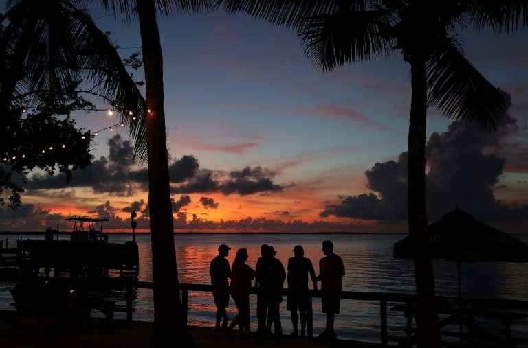 Coucher de soleil sur Key Largo, en Floride(États-Unis), dans le Golfe du Mexique, autre point chaud de la planète menacé par la montée des océans, en octobre 2019. © Joe Raedle, Getty Images North America, AFP, Archives
