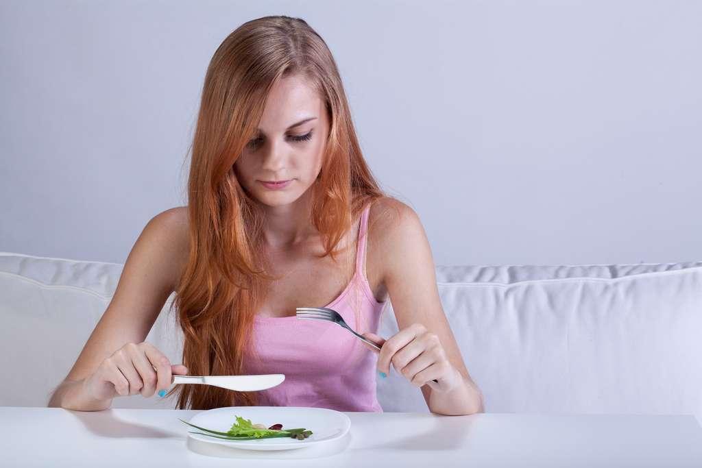 Les repas peuvent être source de conflits avec la famille, avec des discussions sans fin sur l'alimentation. © Photographee.eu, Shutterstock