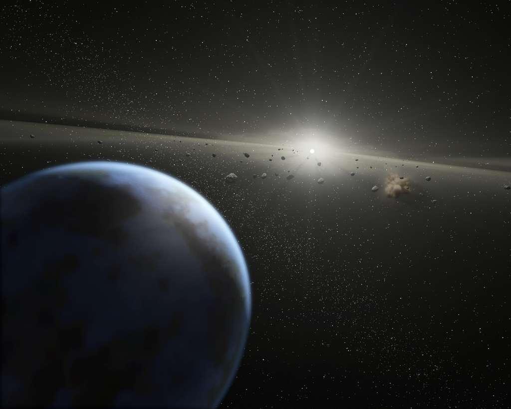 Autour d'une naine blanche, certaines des planètes tournant autour d'elle peuvent avoir survécu à la phase géante rouge de cette étoile. Comme le montre cette image d'artiste, la naine blanche serait entourée d'un disque de débris et d'exoplanètes restantes. © Nasa-JPL / Caltech / T. Pyle (SSC)