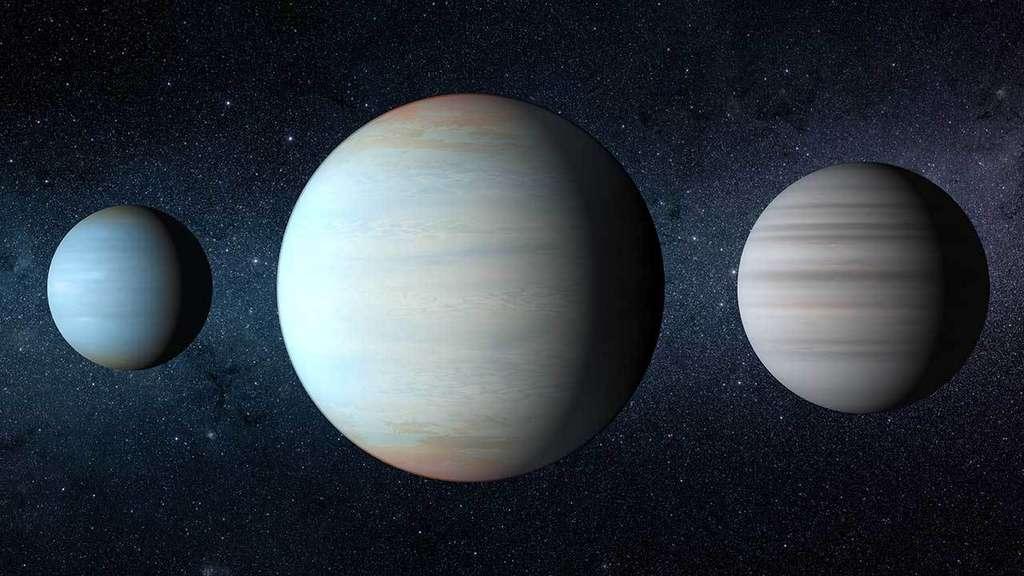 Vue d'artiste des trois exoplanètes en orbite autour de l'étoile double Kepler 47. Celle de gauche est Kepler 47b, celle de droite est Kepler 47c. Elles ont été découvertes en premier. Au milieu, se trouve la planète la plus récemment découverte, Kepler 47d. Leur ordre de découverte ne correspond pas à leur ordre dans le système planétaire. © Nasa/JPL Caltech/T. Pyle