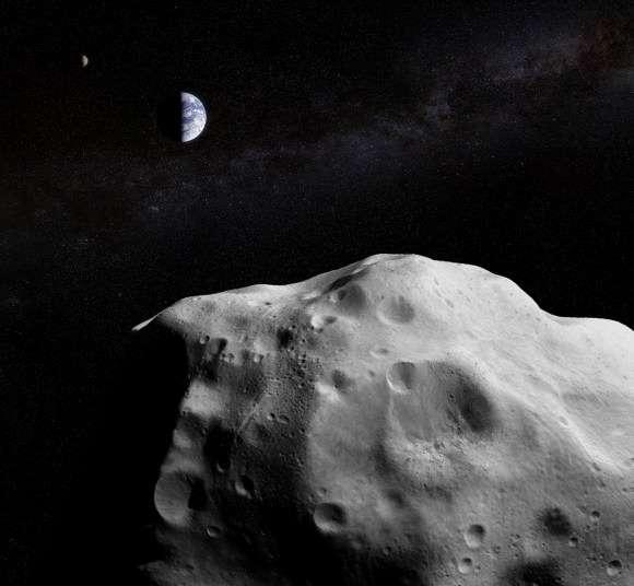 Le géocroiseur YB35, au premier plan de l'image composite, est passé près de la Terre le 27 mars 2014. Il repassera dans les parages en 2033. © J. Major