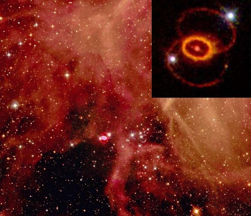 Le rémanent de la supernova SN 1987A dans le Grand Nuage de Magellan, hors de notre Galaxie, est observé de plus près par le télescope spatial Hubble en haut à droite de cette image. Les deux points brillants sont des étoiles d'avant-plan. Sur les trois anneaux visibles, l'anneau central délimite l'extension actuelle du rémanent. Les anneaux extérieurs, plus grands et plus faibles, résultent de phénomènes de perte de masse antérieurs à la supernova. © Nasa, Wikipédia, DP