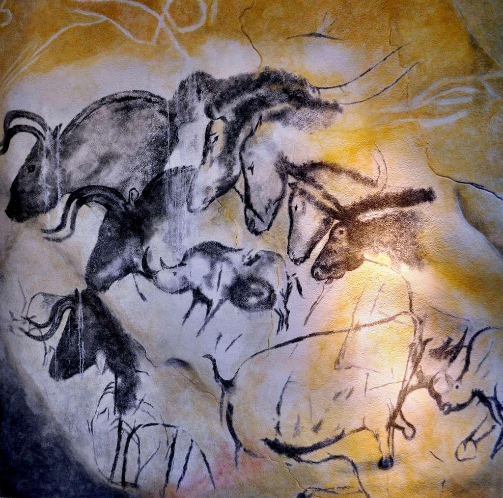 Œuvre pariétale représentant des chevaux, des aurochs et des rhinocéros