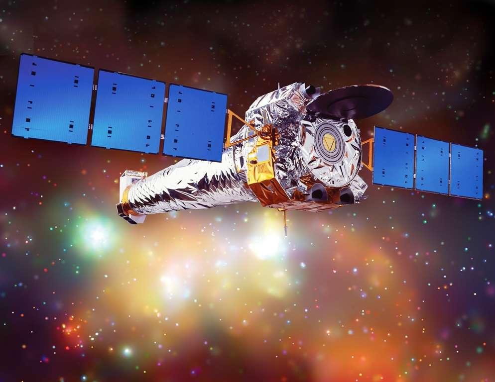 Une vue d'artiste de Chandra en plein travail. Sa sensibilité aux rayons X a révolutionné l'image que l'on se faisait de l'univers, par exemple avec la matière noire. © Nasa