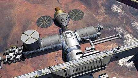 Le vaisseau Orion, reconnaissable à ses panneaux solaires ronds, amarré à la Station Spatiale Internationale. Cliquer pour agrandir. Crédit Nasa