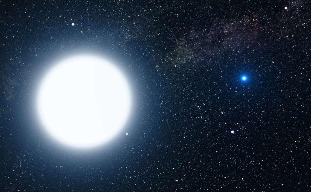 Vue d'artiste représentant l'étoile double Sirius. La plus grosse des deux étoiles, Sirius A, se situe à gauche ; à droite, en bleu, Sirius B. © Nasa