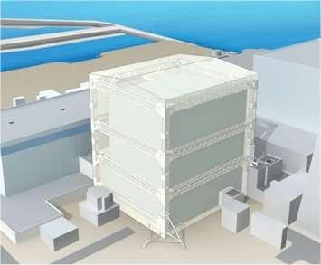 Le projet de bâtiment pour couvrir le réacteur numéro 1 de Fukushima-Daiishi. Les travaux de préparation ont commencé aujourd'hui pour aplanir le terrain alentour et permettre d'amener des engins de chantier de grandes tailles, ce qui réduira les temps d'exposition des ouvriers chargés du travail. © Tepco