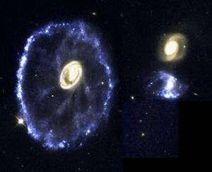 """Image de la galaxie de la """"Roue du chariot"""". Située à 500 millions d'années-lumière dans la galaxie du sculpteur elle résulte de la collision d'une galaxie naine avec une grande galaxie. Le diamètre de l'anneau est de 150 000 années-lumière, c'est plus grand que la taille de notre Galaxie (Crédit: NASA, ESA, and K. Borne (STScI) )."""