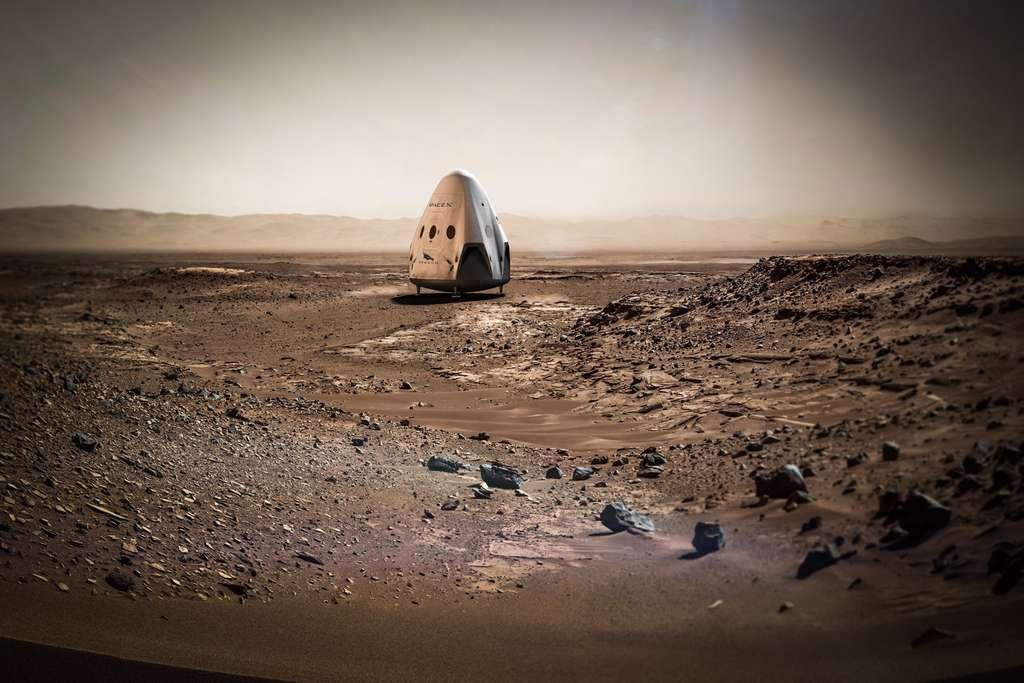 Illustration de la capsule Red Dragon, Dragon 2, venant de se poser sur Mars grâce à ses propulseurs, comme cela est prévu pour 2018. Le paysage alentour est réel : c'est celui du cratère Gale photographié par Curiosity. Ce n'est pas là, toutefois, que devrait se poser la capsule Dragon. © SpaceX, Nasa