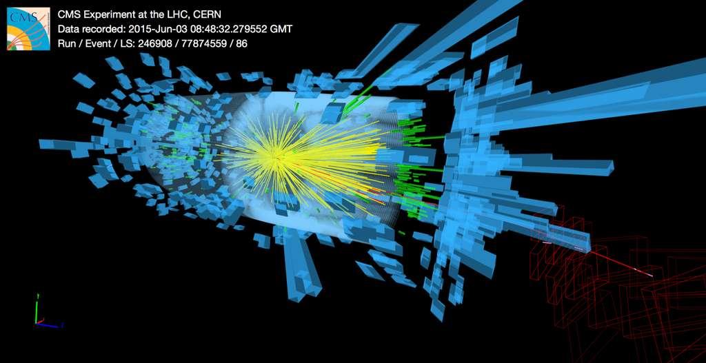 Première image de collision dans l'expérience CMS. Les cylindres bleus montrent l'énergie des particules dans les calorimètres du détecteur et les lignes jaunes les traces des particules dans le trajectographe. © Cern