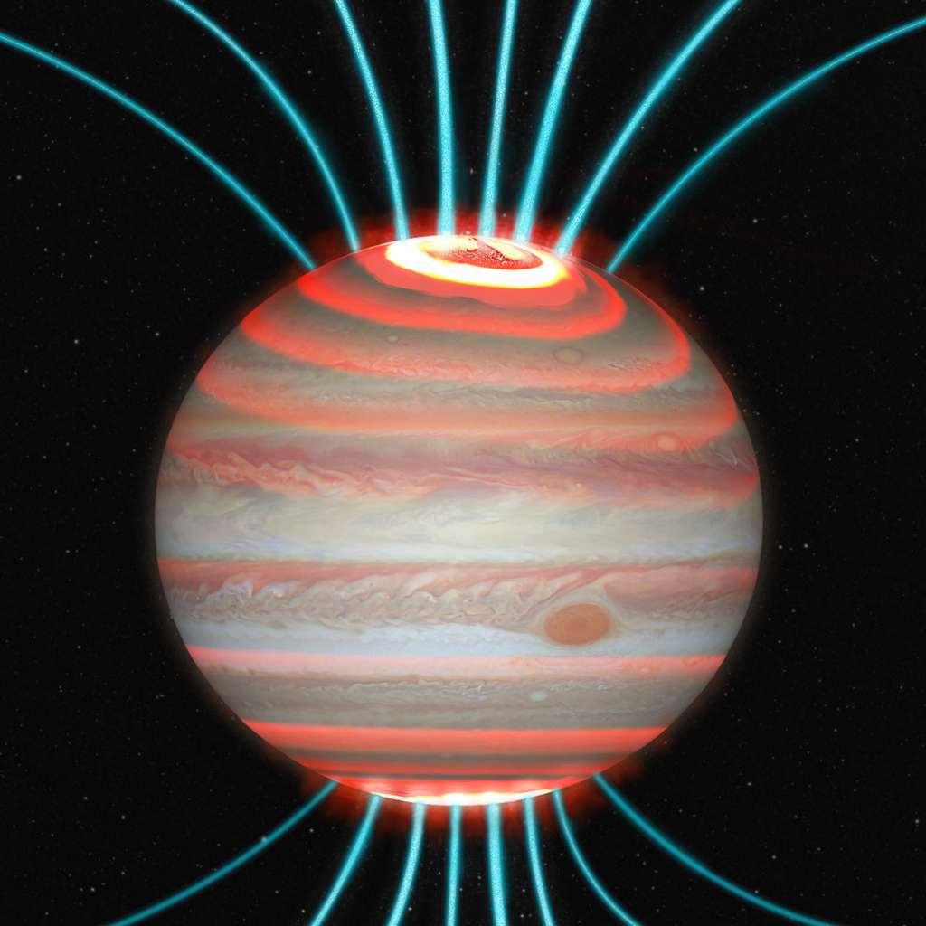 Jupiter est montrée en lumière visible avec, comme dans la vidéo ci-dessus, une impression artistique de la lueur infrarouge de la haute atmosphère jovienne superposée, ainsi que des lignes de champ magnétique (lignes bleues). © J. O'Donoghue (Jaxa)/Hubble/Nasa/ESA/A. Simon /J. Schmidt