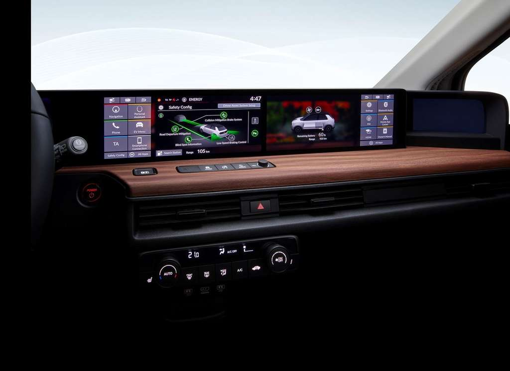 The passenger has a digital tactile dashboard.  For the driver, the voice is the driver.  © Honda
