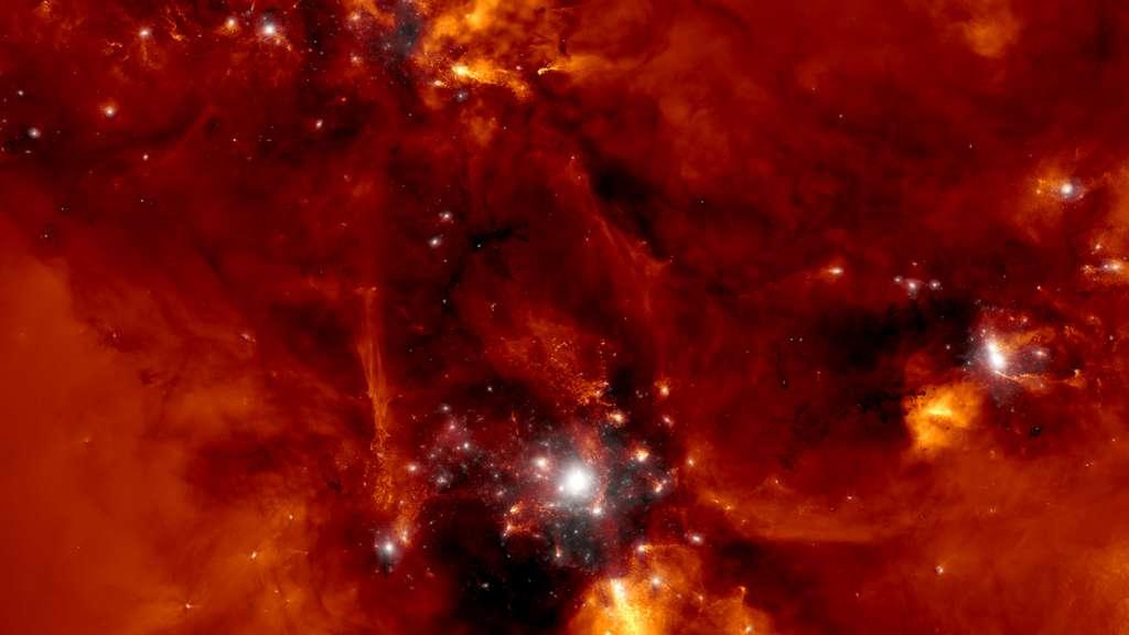 Pour suivre plus de 20 milliards de particules représentant la matière noire, les étoiles, les gaz cosmiques, les champs magnétiques et les trous noirs supermassifs, la simulation TNG50 a mobilisé 16.000 cœurs sur le supercalculateur Hazel Hen de Stuttgart (Allemagne) 24 heures sur 24 et 7jours sur 7 pendant plus d'un an. Ici, une région de formation galactique telle que vue par la simulation. © TNG Simulations