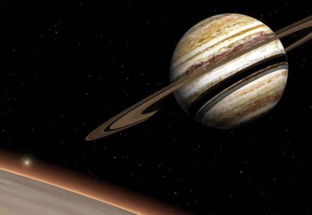 Une vue d'artiste de 16 Cygni B b à partir d'une exolune en orbite autour d'elle. Anneaux et exolunes sont des spéculations mais l'exoplanète en orbite autour de 16 Cygni B existe bien. À travers l'atmosphère de l'exolune, on voit l'étoile 16 Cygni A. © Wikipédia-Nuclear Vacuum
