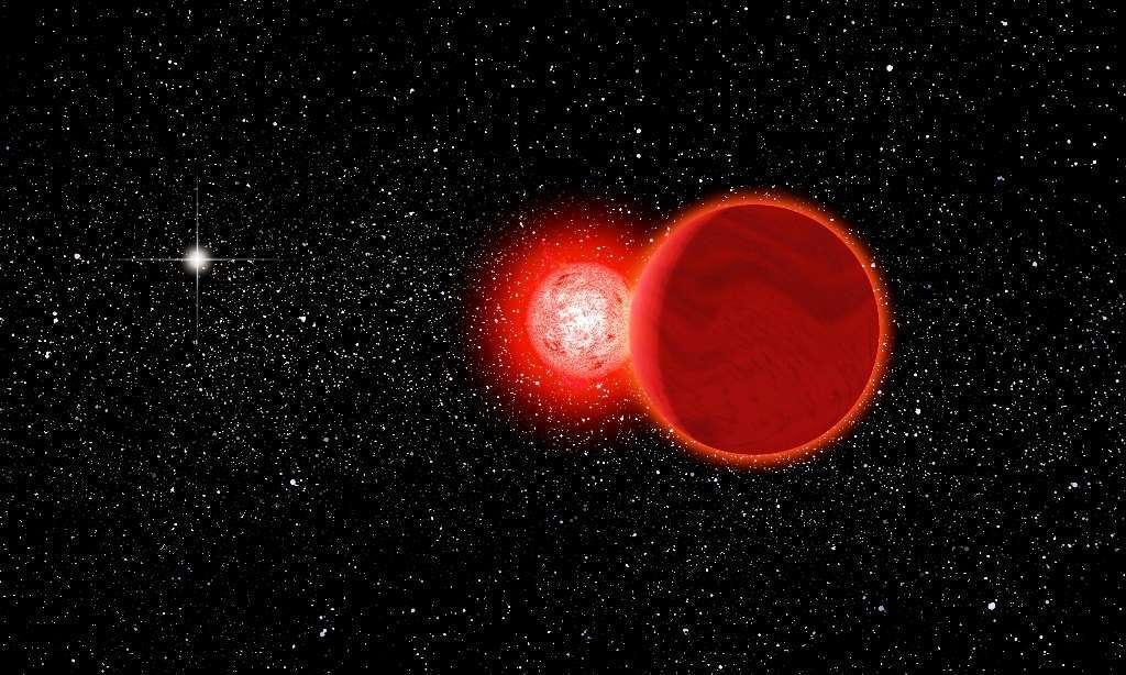 Une vue d'artiste de l'étoile de Scholz, en fait un système binaire composé d'une naine brune en orbite autour d'une naine rouge. © Michael Osadciw, University of Rochester