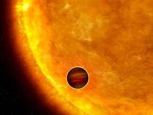 Image d'artiste d'un Jupiter chaud passant devant son soleil (Credits: NASA, ESA et G. Bacon).