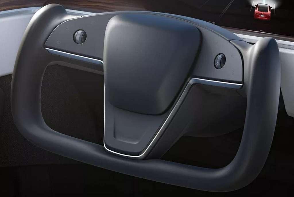 Le volant de la Tesla Model S 2021 intègre des boutons en lieu et place des leviers de commandes classiques. © Tesla
