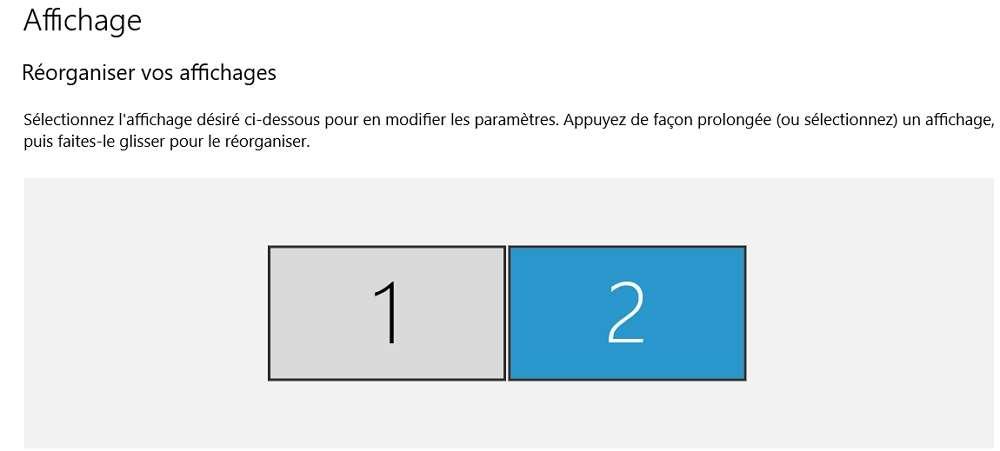 Par défaut, les deux écrans sont alignés de manière horizontale. © Microsoft