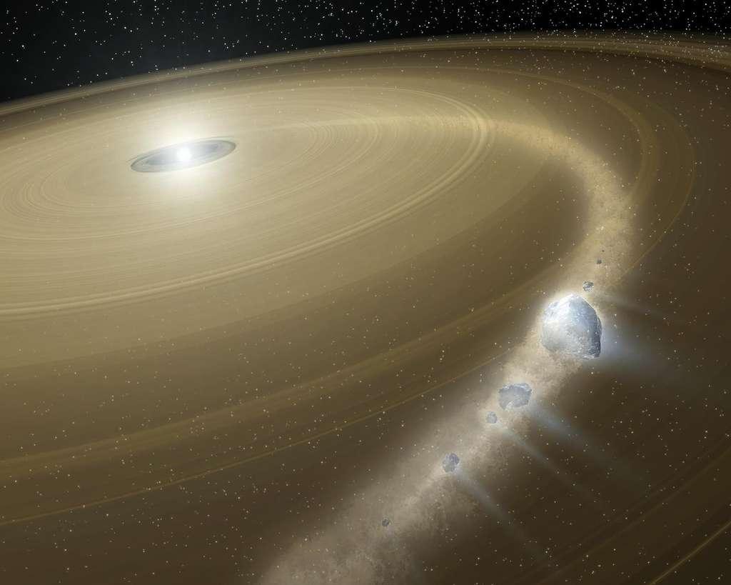 Une représentation d'artiste d'une jeune étoile entourée de son disque de débris. Une comète morcelée par une collision y est bien visible. © DP, Wikipédia