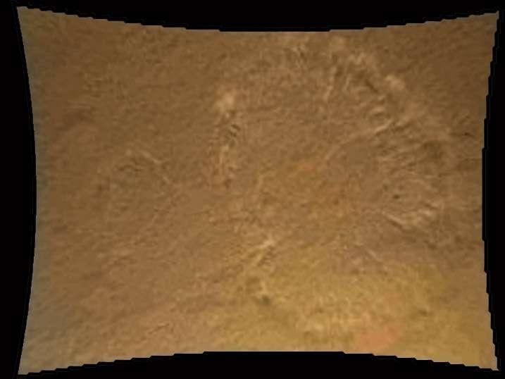 Photographié par une caméra installée sous le rover et baptisée Mardi (Mars Rover Descent Imager), le nuage de poussière soulevé par les fusées de la grue volante juste avant l'atterrissage. © Nasa, JPL-Caltech, MSSS
