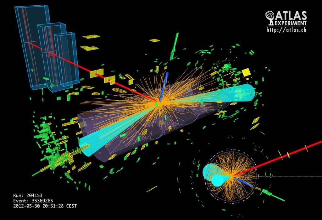 Cette image issue des données d'Atlas correspond à la production de deux leptons tau, un tauon et son antiparticule, par la désintégration d'un boson de Brout-Englert-Higgs. L'un des tauons s'est ensuite désintégré en un électron (ligne bleue) et un muon (ligne rouge). Ce sont surtout les modes de désintégration du boson BEH en deux photons ou deux bosons W ou Z qui avaient été observés jusqu'ici. La détection d'indices convaincants de modes de détection fermioniques est une première. © Cern