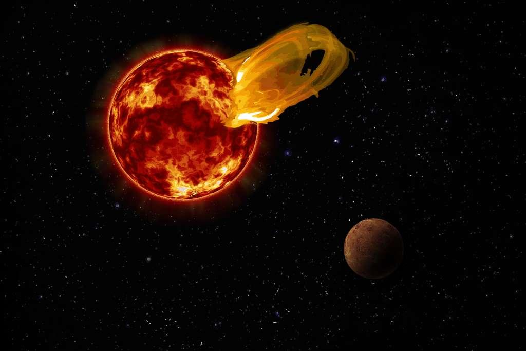 Une vue d'artiste d'une éruption stellaire de l'étoile Proxima Centauri. L'exoplanète Proxima b orbite autour de son étoile 20 fois plus près que la Terre autour du Soleil. Une éruption stellaire 10 fois plus forte que les plus puissantes éruptions solaires produit donc un rayonnement 4.000 fois plus intense à la surface de cette exoplanète que dans le cas de la Terre. © Roberto Molar Candanosa, institut Carnegie pour la science, Nasa, SDO, JPL