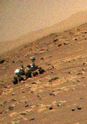 Pour la première fois lors de son vol du 25 avril 2021, Ingenuity a eu l'occasion de prendre en photo le rover Perseverance. © Nasa, JPL-Caltech