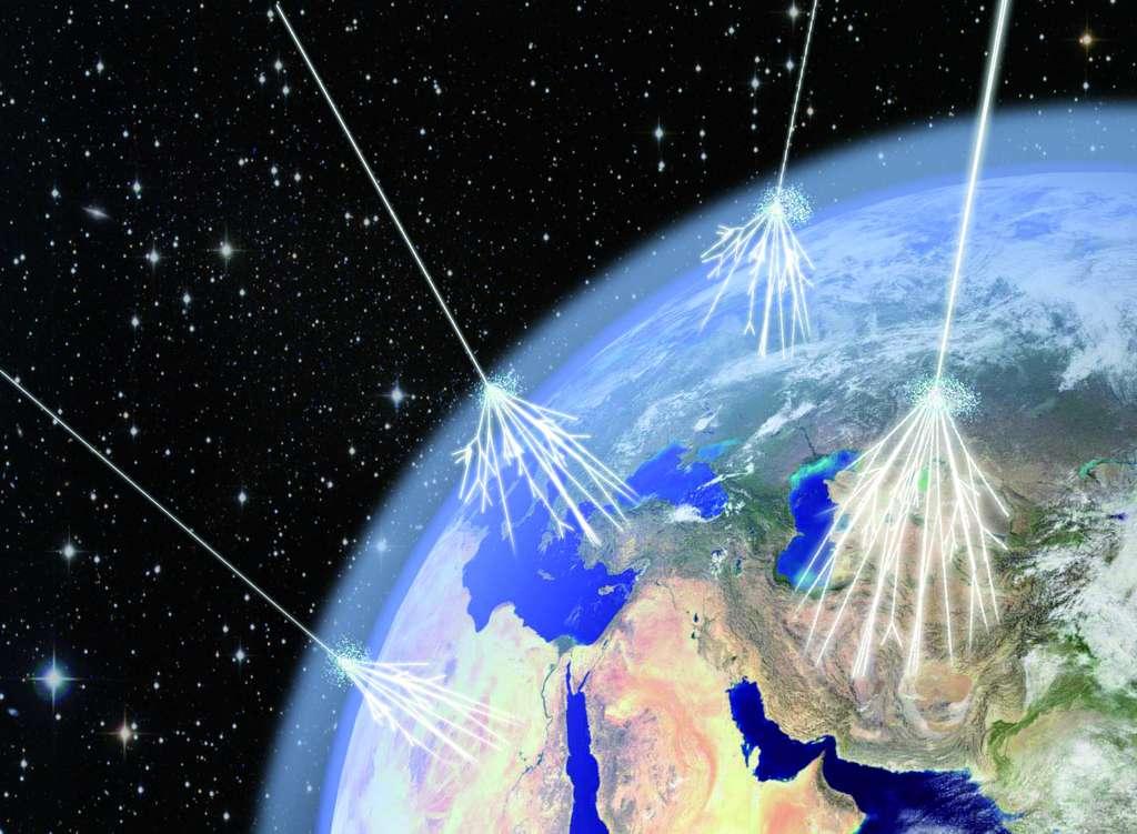 Une vue d'artiste des rayons cosmiques entrant en collision avec les noyaux de l'atmosphère et provoquant des gerbes de particules secondaires atteignant le sol de la Terre. © Asimmetrie/Infn