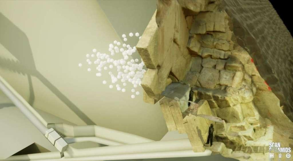 Dessin des chevrons mis au jour au fil des siècles par l'arrachage de blocs de pierre de la façade nord. Les globules blancs indiquent les zones où la muographie a détecté un déficit de matière. La forme et la dimension de cette cavité restent inconnues. Le dessin montre les couloirs. © ScanPyramids