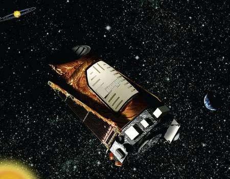 Kepler en orbite héliocentrique, avec la Terre en arrière-plan (vue d'artiste). Crédit Nasa
