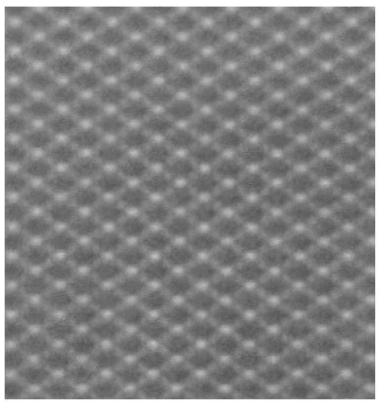 Image a : paires de monopôles magnétiques obtenues grâce à la technique de microscopie électronique de PEEM (PhotoEmission Electron Microscopy), les images ci-dessous (b puis c) montrent des zones sombres qui correspondent aux endroits où le sens d'aimantation a été inversé. Ici, toujours en PEEM, aucun monopôle n'est encore visible. © PSI
