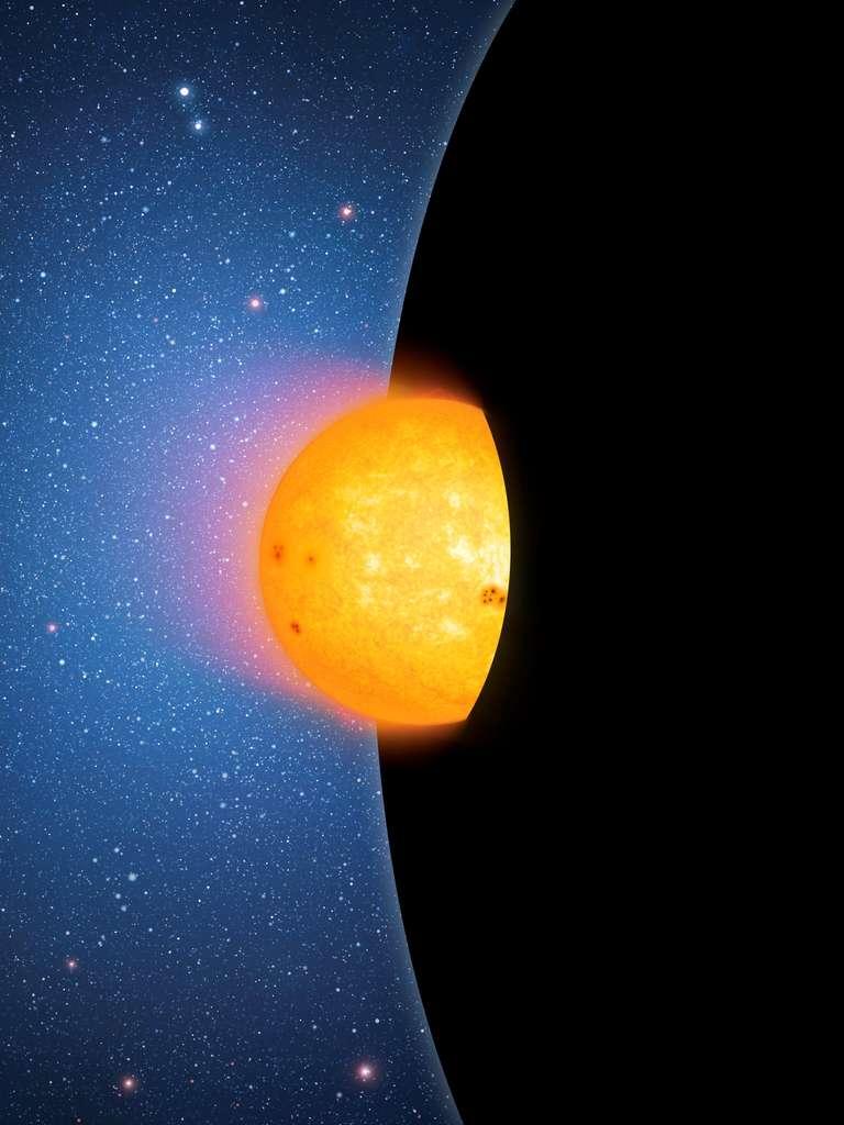 Une vue d'artiste d'un trou noir supermassif de plus de 100 millions de masses solaires avalant une naine jaune. © Mark A. Garlick/CfA