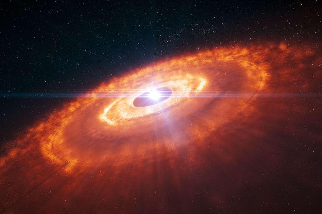 Illustration d'une jeune étoile entourée par un disque protoplanétaire dans lequel des planètes sont en train de se former à l'image de ce qui se passe déjà autour de la très jeune étoile HL-Tauri, à 450 années-lumière de notre Système solaire. Des anneaux concentriques de gaz avec des vides (ou lacunes) indiquant la formation de planètes sont ici visibles comme sur l'image obtenue par Alma. Prédites par les simulations numériques, ces structures ont été observées directement pour la première fois par le vaste réseau d'antennes de l'Eso. © Eso, L. Calçada