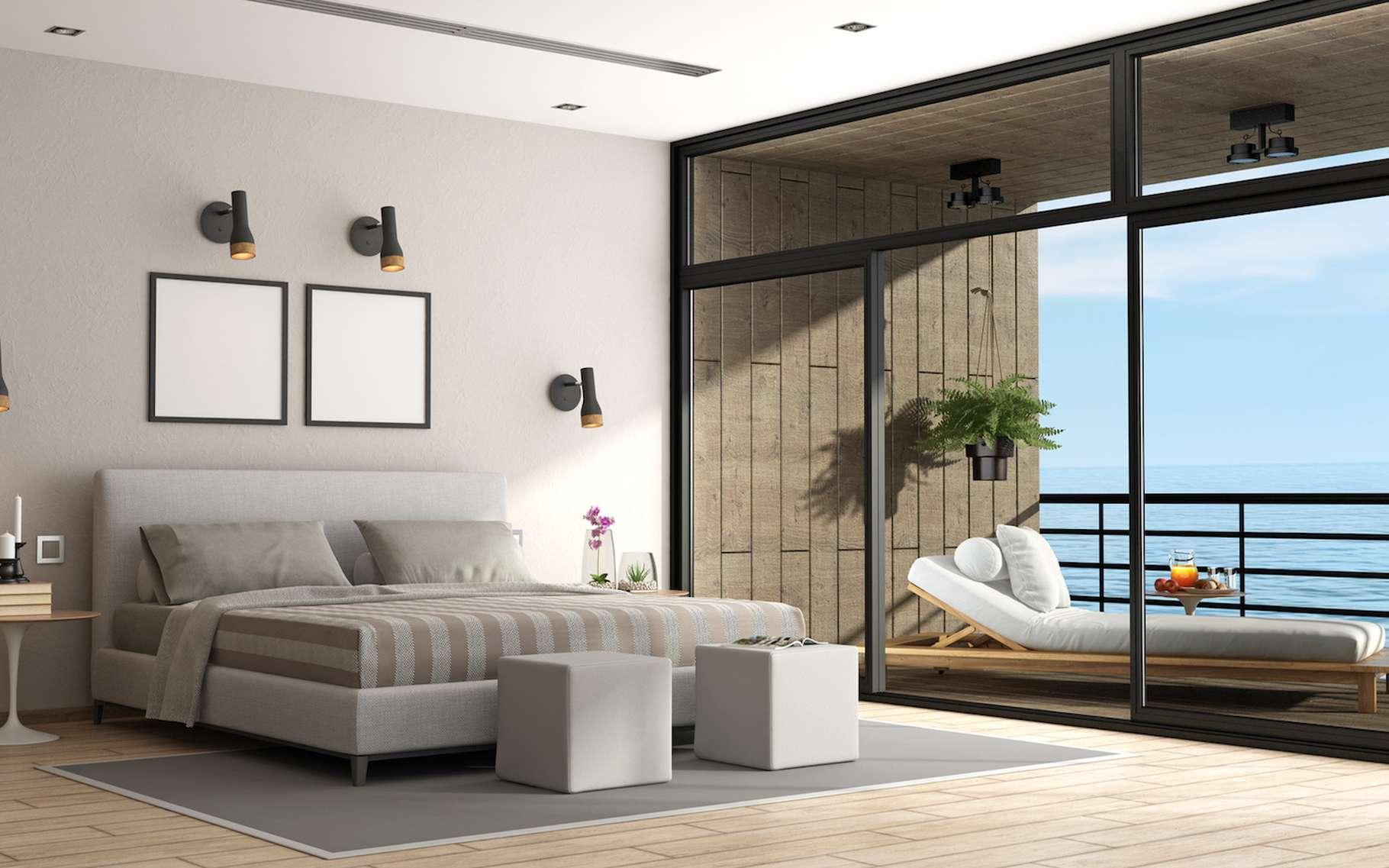 Porte-fenêtre coulissante ou baie vitrée, les deux termes désignent en réalité un seul et même système d'ouverture d'une pièce sur l'extérieur. © archideaphoto, Fotolia