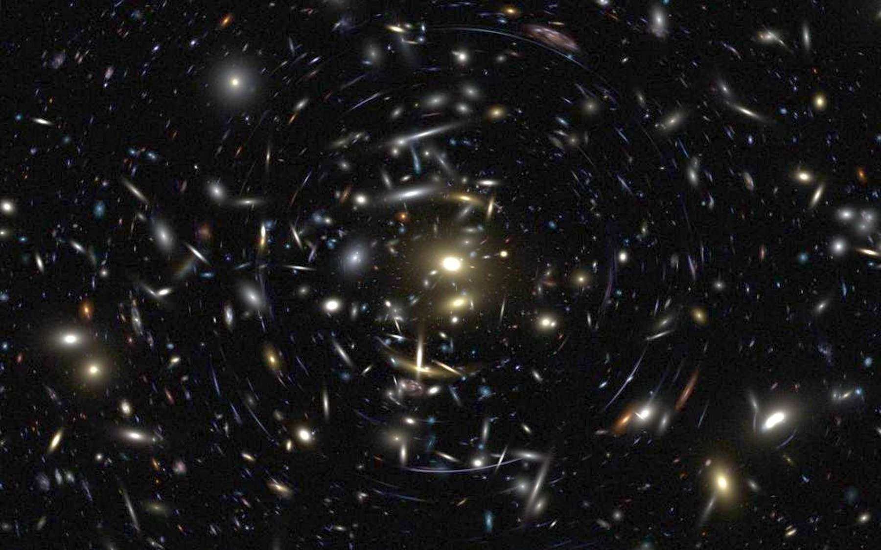 Simulation numérique d'un amas de galaxie tel que ceux utilisés par les astrophysiciens pour mesurer la masse de l'univers. © Rychard Bouwens, ACS Team, Nasa